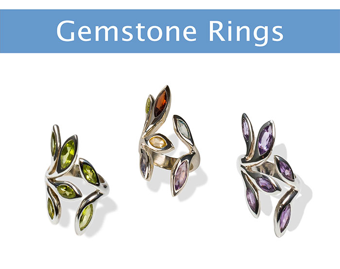 three silver rings featuring colourful gemstones