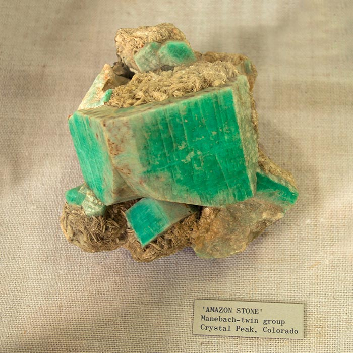 amazonite mineral in a museum display cabinet