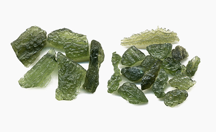 two groups of green moldavite stones side by side