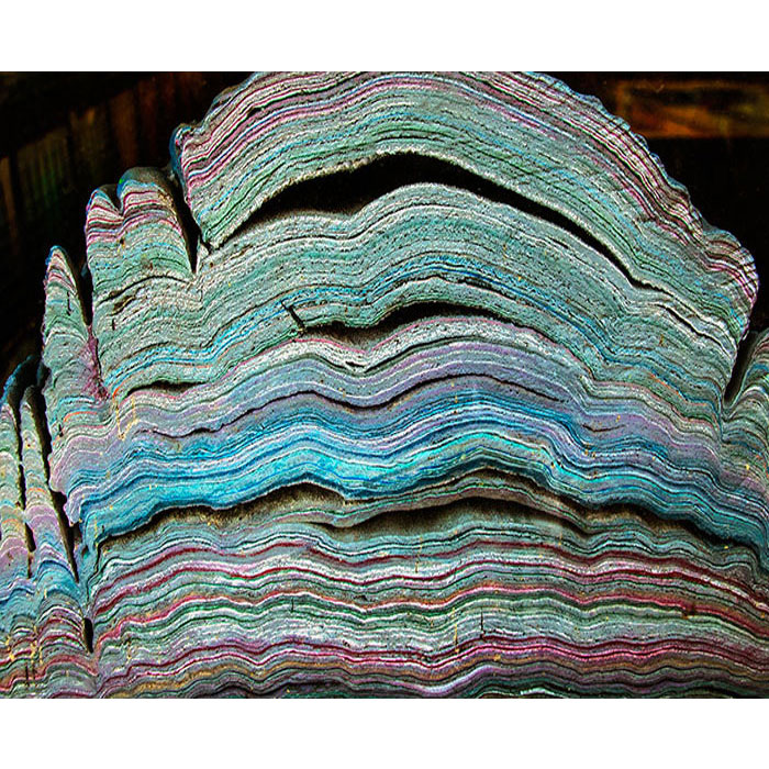 manmade rainbow calsilica stone. A close up photo showing the individual coloured layers