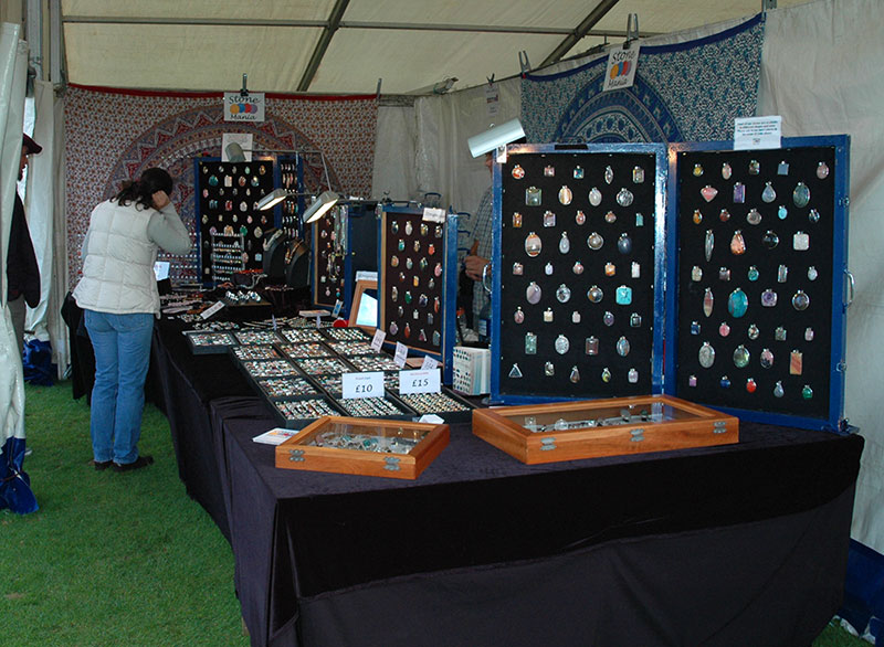 large jewellery stand at a county show with a female customer browsing