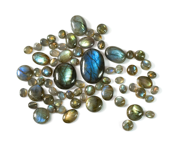 collection of different sized labradorite cabochons isolated on a white background