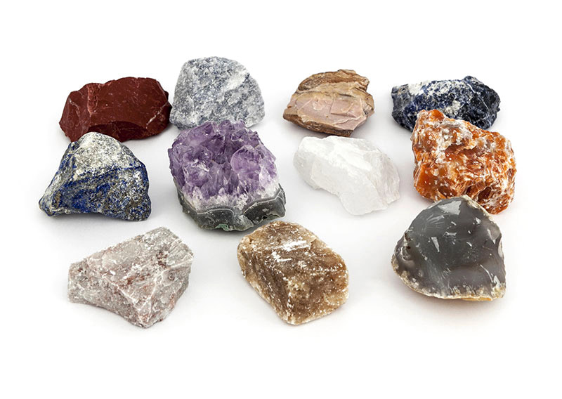 eleven small rough rocks and minerals grouped together