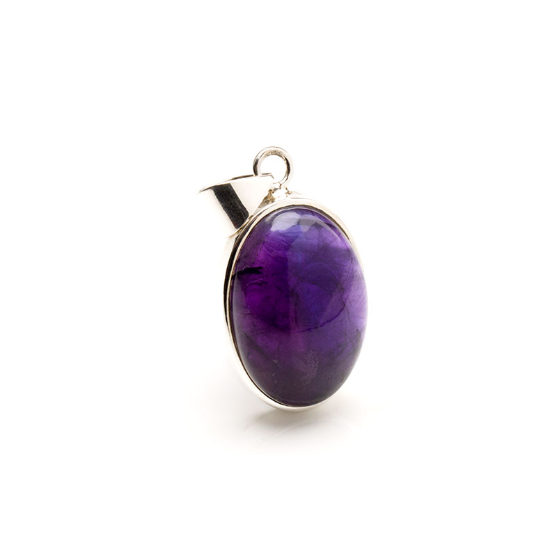 oval shaped amethyst cabochon crafted as a ladies pendant in sterling silver