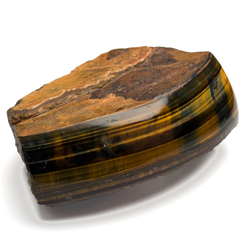 wedge of the mineral tigers eye with the front being polished