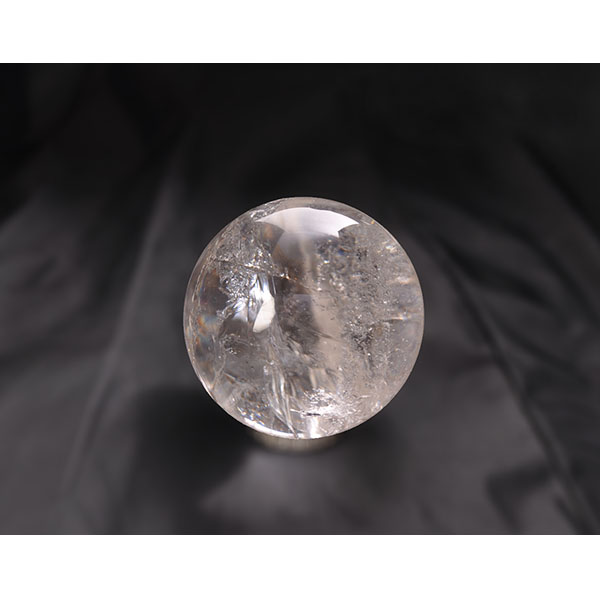 round quartz crystal ball with a glass-like appearance but full of crystals