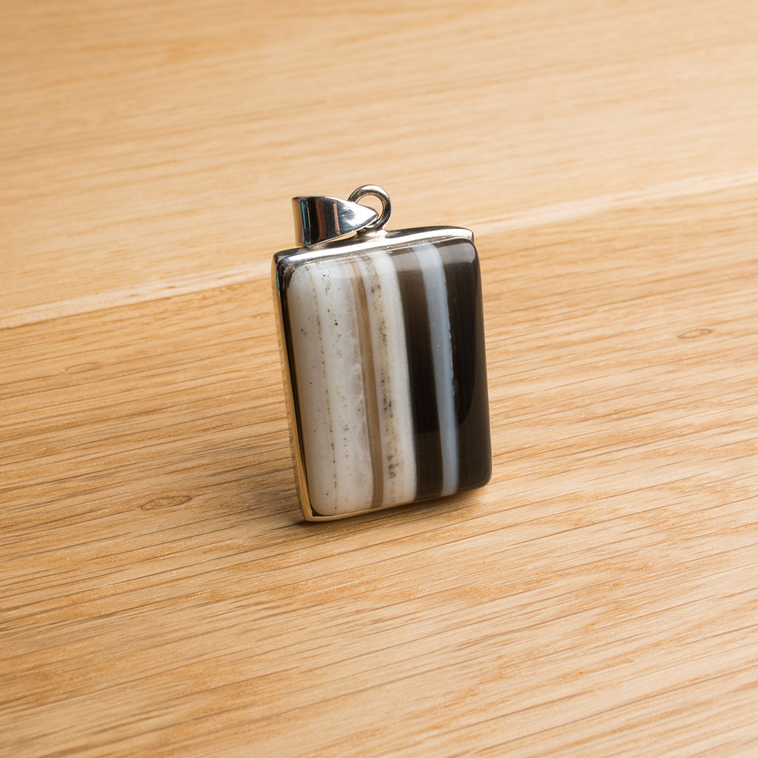 rectangular shaped sterling silver ladies pendant featuring an onyx gemstone