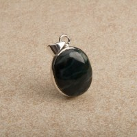 Deep blue green coloured agate gemstone mounted as a ladies pendant in sterling silver