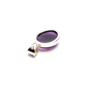 Ladies necklace pendant featuring an amethyst quartz cabochon mounted in sterling silver