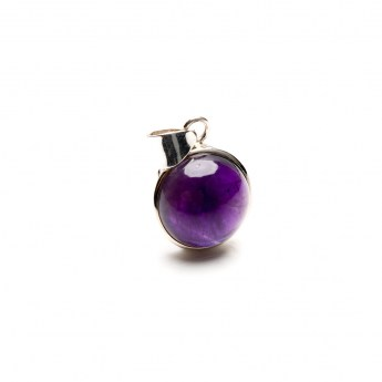 round amethyst pendant featuring a small rich purple coloured cabochon gemstone