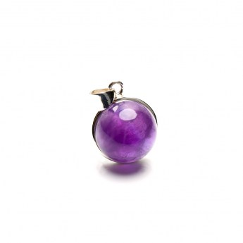 round amethyst pendant featuring a small bulbous shaped cabochon gemstone