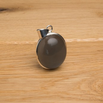 Dark silver grey coloured moonstone mounted as a ladies pendant in sterling silver