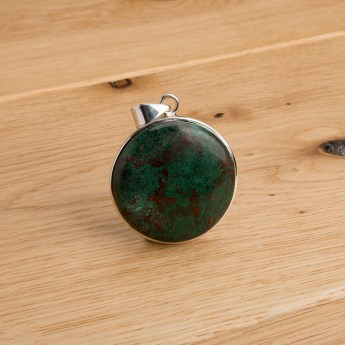 round bloodstone gemstone crafted as a ladies pendant in sterling silver