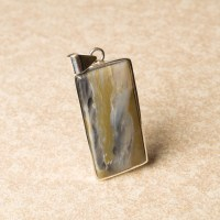 oblong shaped polychrome jasper gemstone crafted as a ladies pendant in sterling silver