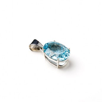 sky blue coloured blue topaz gemstone crafted as a ladies pendant in a sterling silver setting
