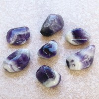 collection of large chevron amethyst polished stones