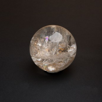 quartz crystal ball with visible crystallization