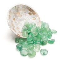 green fluorite crystals around a mother of pearl decorative dish thats up on its side