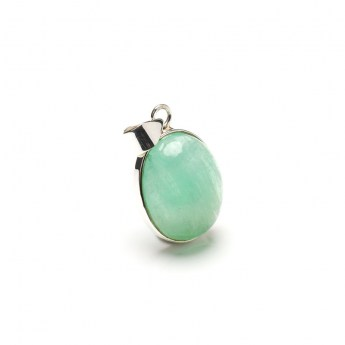 translucent green fluorite gemstone crafted as a ladies pendant in sterling silver