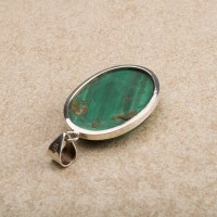 rich green coloured malachite gemstone crafted as a ladies pendant
