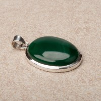 dark green coloured malachite gemstone mounted as a pendant in sterling silver