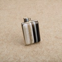 rectangular shaped onyx gemstone mounted as a ladies pendant in sterling silver