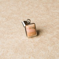 small rectangular shaped pink opal gemstone crafted as a ladies pendant in sterling silver