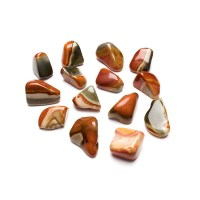 group of polychrome jasper crystals on a white background
