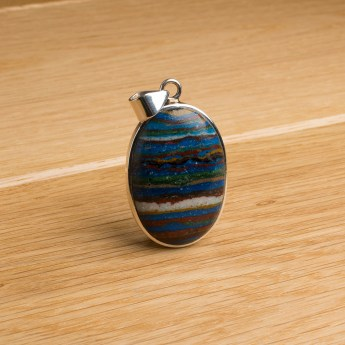oval shaped rainbow calsilica pendant necklace crafted in sterling silver
