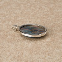 rainbow calsilica a gemstone with colourful vertical stripes mounted as a ladies pendant