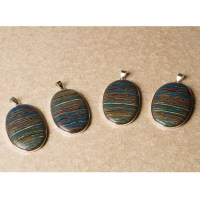 four rainbow calsilica stones mounted as ladies pendants in sterling silver