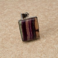 rainbow fluorite gemstone crafted into a ladies pendant