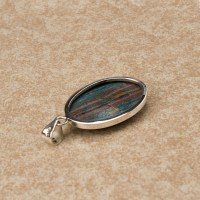 sterling silver ladies pendant featuring the synthetic gemstone rainbow calsilica
