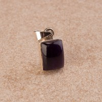 small amethyst pendant encased in sterling silver