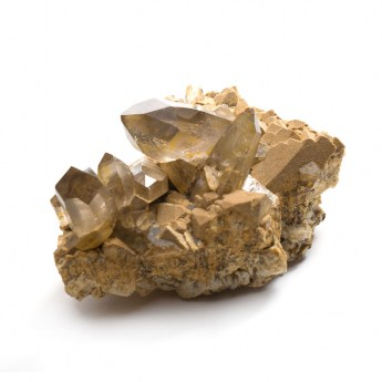 cluster of smoky quartz terminated points embedded in rock matrix