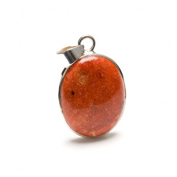 sponge coral polished cabochon mounted in a sterling silver setting as a ladies pendant