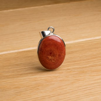 sterling silver pendant featuring an oval shaped sponge coral gemstone