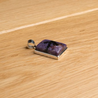 sterling silver pendant necklace featuring a rich purple coloured sugilite gemstone