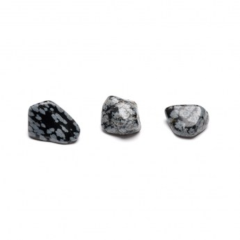 a line of three snowflake obsidian tumbled stones