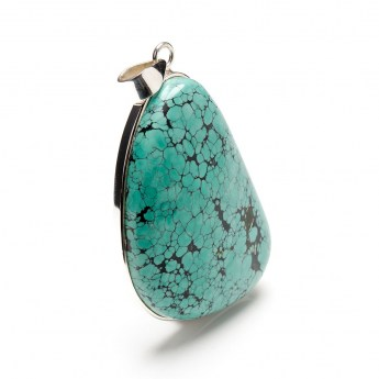 large and chunky turquoise gemstone crafted as a ladies pendant in a sterling silver setting