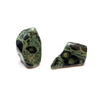 two kambaba jasper healing crystals isolated against a white background