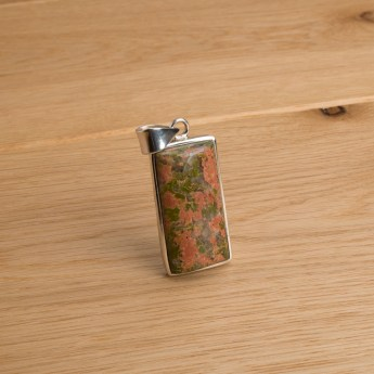 oblong shaped unakite gemstone pendant crafted in sterling silver