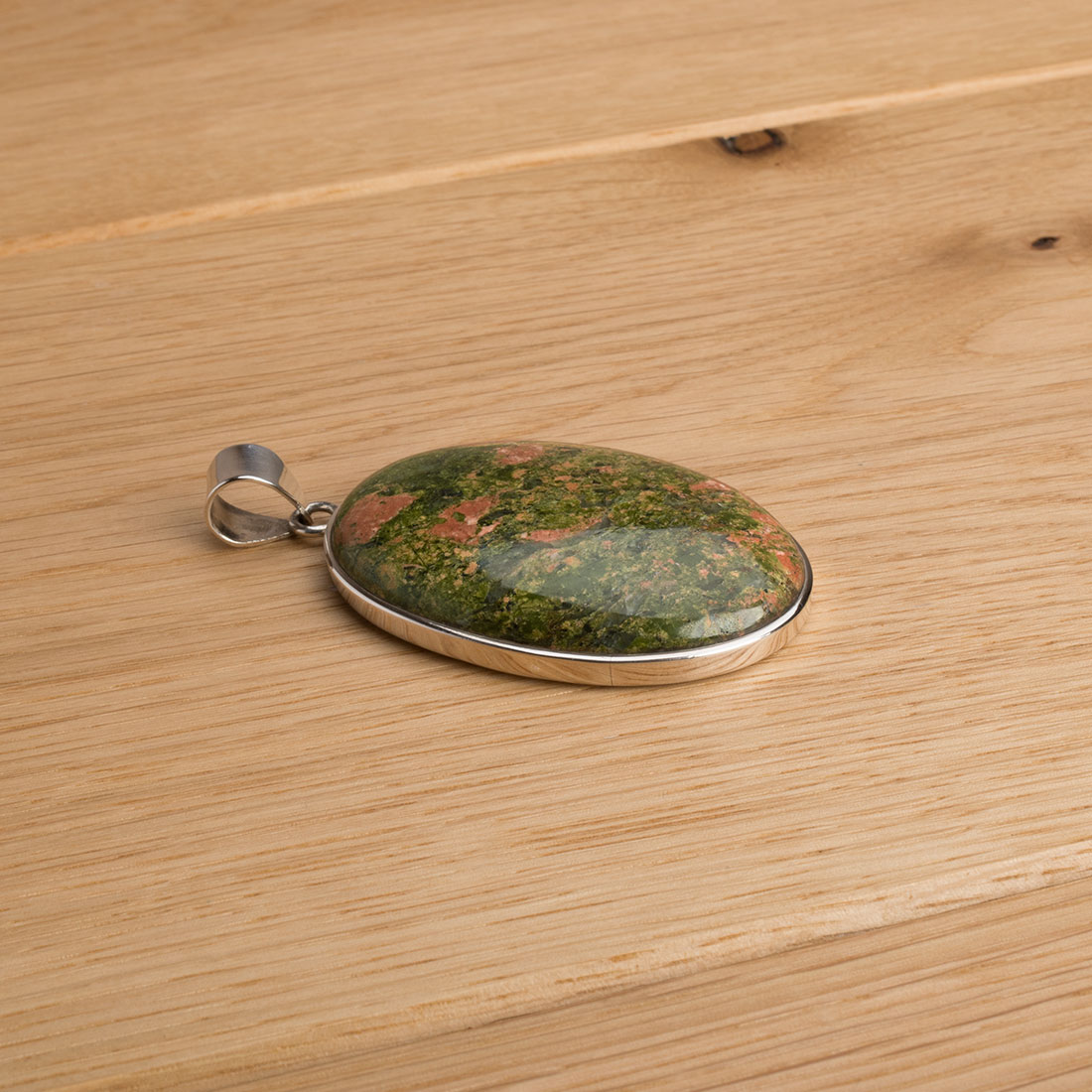 large oval shaped unakite pendant crafted in sterling silver